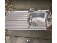 Stainless steel sink and tap