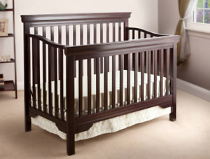 Crib convertible to toddler bed.