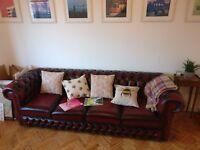 4 Seat, Antique Oxblood Chesterfield Sofa (As New)