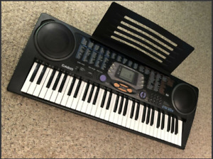 Casio 61 Key Electronic Keyboard With Onboard Music Holder. MINT