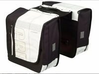 new double pannier set with lockable mechanism secures panniers to rear pannier rack -mint condition