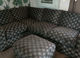 Beautiful used DFS gray and brown corner sofa with foot stool