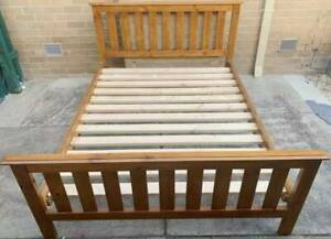 Good condition wooden queen bed frame for sale. Pick up or deliver