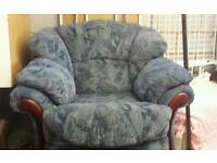 2 lovely blue armchairs 1 is a recliner