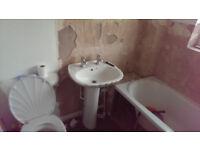 coral white bathsuite, toilet sink & bath