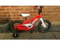 """12""""wheel specialized kids bike."""