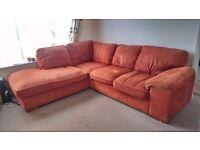 Corner sofa in sunburnt orange fabric, very good condition. Collect from EX6.