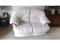 Arctic white leather 3 piece suite (two rockable armchairs and 2 seater sofa).