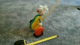 Push along wooden clown