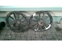 pair of antique cart wheels or carriage wheels