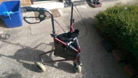 Three wheeled walking aid