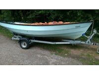 Drascombe Dabber Sailing Boat, with good solid trailer and full set of tan sails.