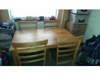Julian Bowen solid wood dining table and 4 upholstered chairs (like new)