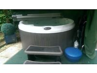 Jacuzzi J210 4 seater jacuzzi as new