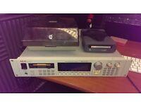 Akai S3000XL sampler, with sample discs and iomega 2GB Jaz drive