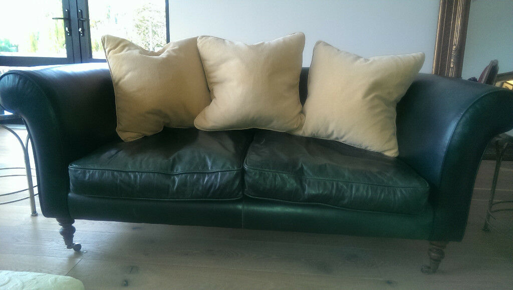 Green leather sofa by Tetrad