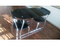 Small Black Tempered Glass Breakfast Table and two chairs