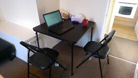 Foldable Table with 4 chairs 95% new