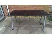 A very good condition glass table for sale