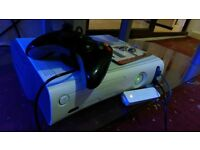 Xbox 360 Arcade Complete with Wi-Fi dongle and games , controller charger pack included
