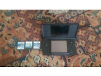 Black Nintendo ds with 3 games