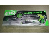 Brand new Evo 2-Wheel Inline Scooter, silver and green