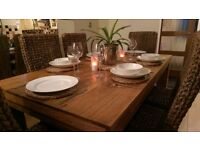 Solid Oak Dining table with 6 wicker chairs