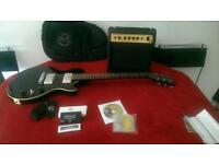 Gibson Baldwin black electric guitar with gibson Baldwin amp