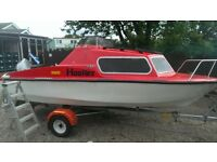 fishing boat/cabin cruiser with outboard and trailer