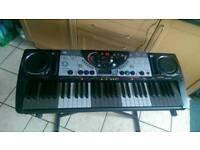 Keyboard Yamaha DJX with stand