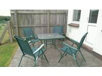 Used green garden furniture set - one table and 4 chairs