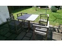 Teak patio table and four chairs