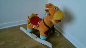 Mamas and Papas talking George Giraffe ride on rocking toy.