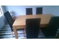 SOLID OAK DINNING TABLE AND 4 BROWN LEATHER CHAIRS ALL IN EXCELLENT CONDITION AND BEEN LOOKED AFTER