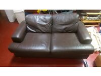 BROWN LEATHER 2 SEATER SOFA AND FOOT REST