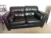 Pair of matching black leather sofas