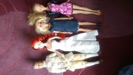 Barbie and Ken plus a selection of clothes