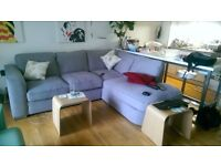 Grey fabric corner sofa, still under warrantee