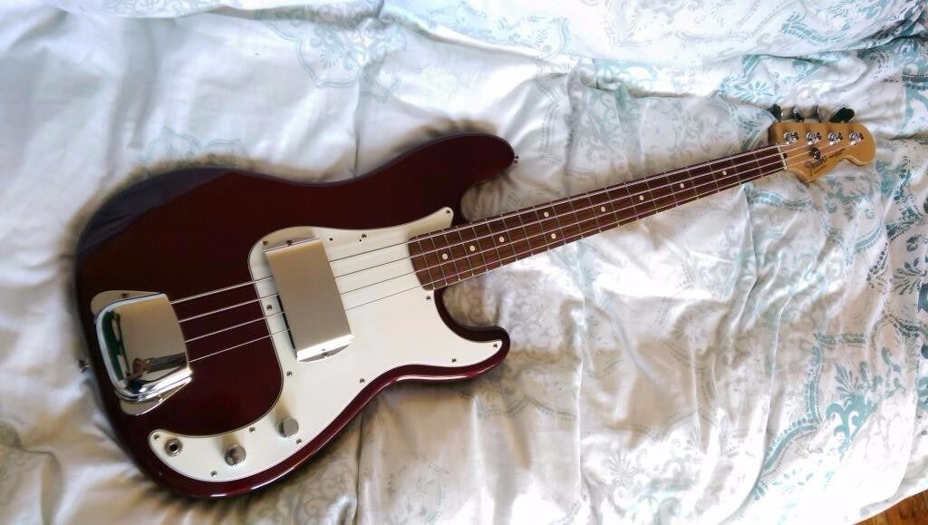 2002 Mexican Fender Precision bass guitar, with hard case and chrome covers.