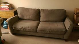 Three-seater fabric sofa