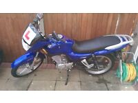 Blue 125cc motorcycle