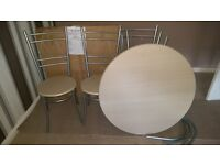 circle dinning table and four chairs
