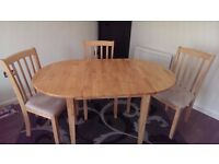 Extending Dinning table and 4 chairs