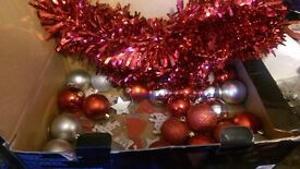 Box of red and silver christmas decs baubles and tinsel