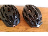 2 almost new helmets large and medium