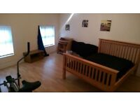 A fully furnished room set in an established residential location close to shops and amenities .