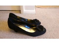 Black suede style pumps with heels. Size 7.