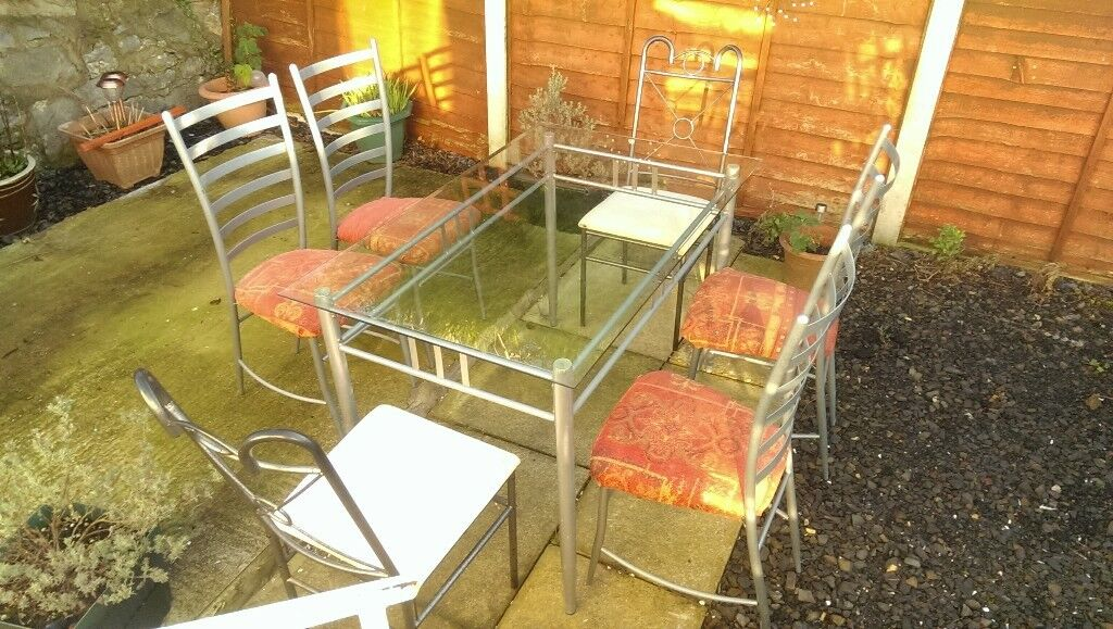 Glass Top Table and 4 chairs + 2 chairs