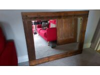 Large mirror made from reclaimed railway sleepers