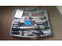 Refractor telescope 600/60 in case with tripod, barlow lenses and planisphere